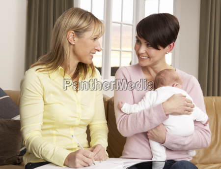 mother with newborn baby talking with
