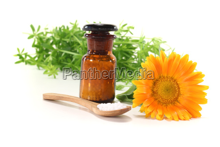homeopathy with pharmacist bottle