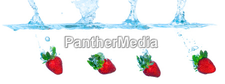 collage fresh strawberry dropped into water