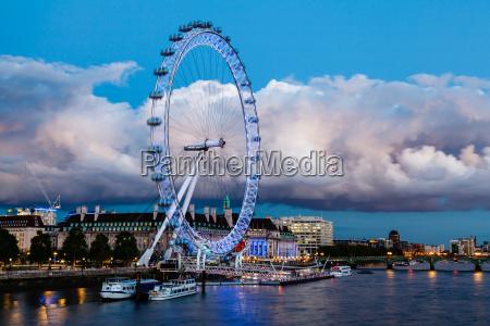 london eye and huge cloud on