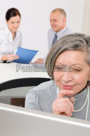executive senior woman business work computer