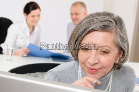 executive senior woman business team meeting