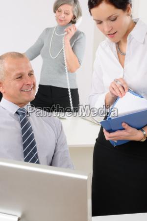 professional mature businessman office secretary