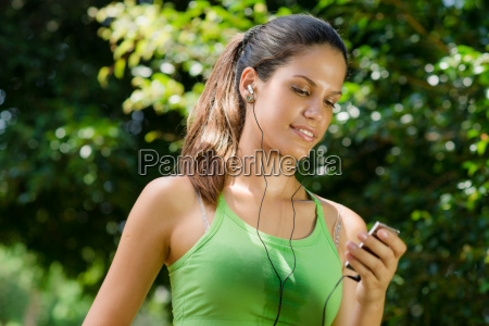 woman with mp3 player listening to