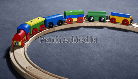 colorful wooden toy train on tracks