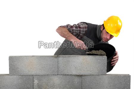 mason building wall