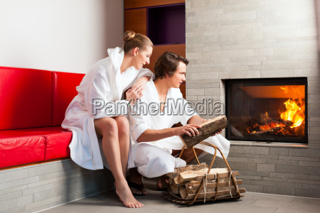 young couple sitting in bathrobe in