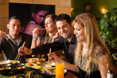 young people eat at a thai