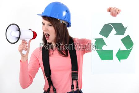 woman increasing recycling awareness