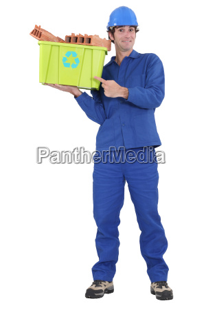 eager tradesman pointing to a recycling