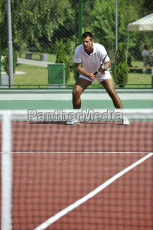 young man play tennis outdooryoung man