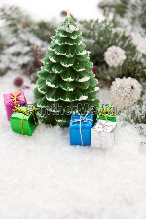 christmas candle in the snow with