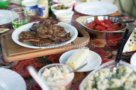 civically covered table with grilled meat