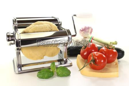 pasta with pasta machine and tomatoes