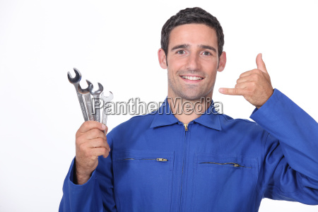 man with spanners making a call