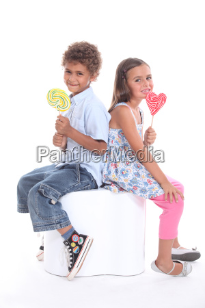 two children with lollipops