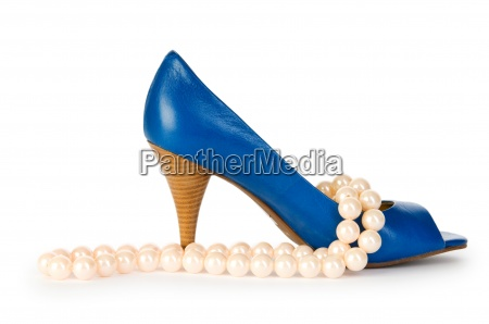 woman shoes and necklace isolated on