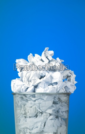 garbage bin with paper waste against