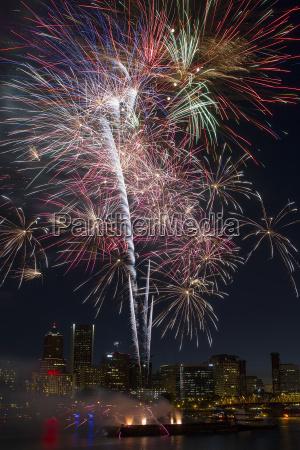 multi color fireworks display over portland