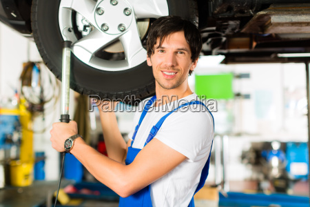 mechanic working on car in workshop