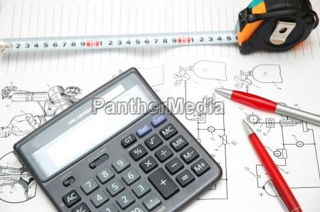 design drawings calculator pens and measuring