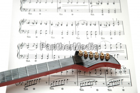 rock guitar over the sheet of