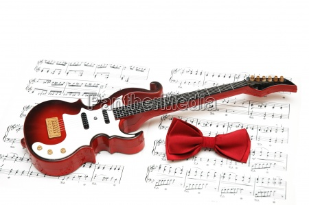 musical notes guitar and bow tie