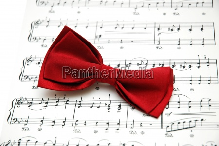 bow tie on sheet of printed
