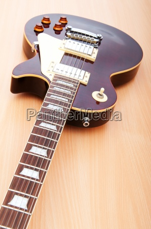 musical concept with wooden guitar