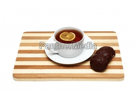 tea with lemon and biscuits isolated