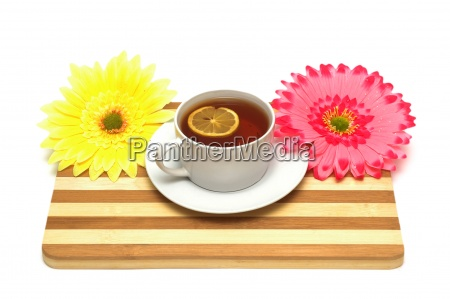 cup of tea on wooden board