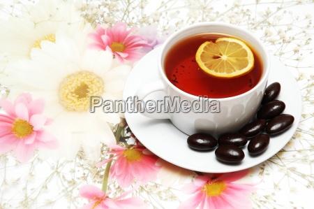 tea with lemon and chocolates on