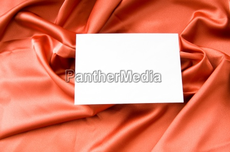 blank message on the red satin