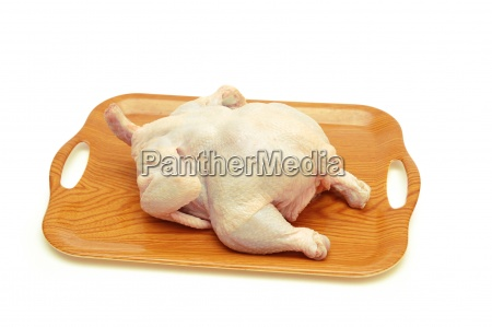 whole raw chicken in the tray