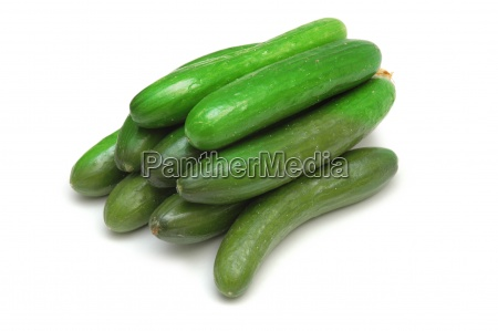 green cucumbers isolated on the white