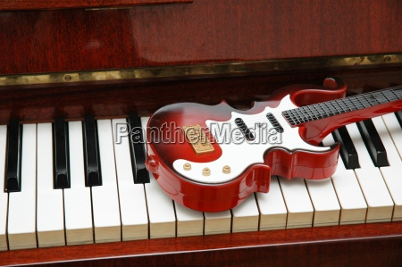 guitar on the piano keys