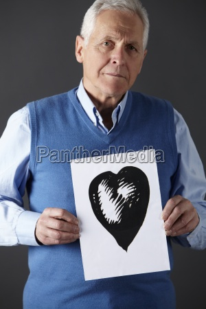 senior man holding ink drawing of