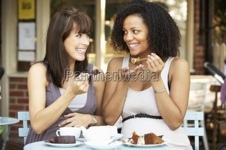 pregnant women sitting outside cafa
