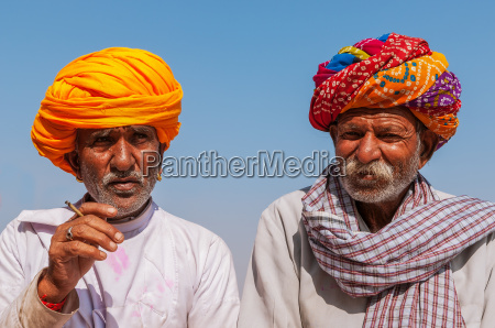 two old indian man with colorful