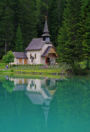 church chapel mirroring steeple mountain lake