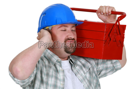 construction worker listening to the sweet