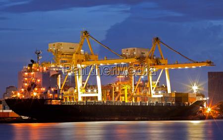 cargo ships at dusk
