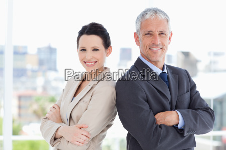 businessman and his young secretary standing