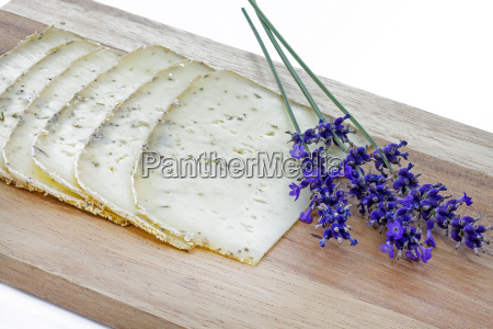 lavender cheese on wooden board