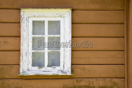 aged house painted window with ages