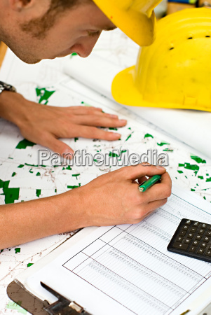 builder checking plans