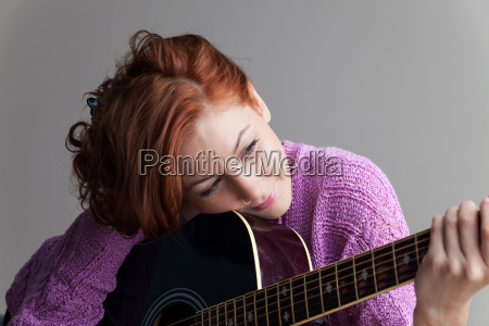 beautiful redhead with guitar