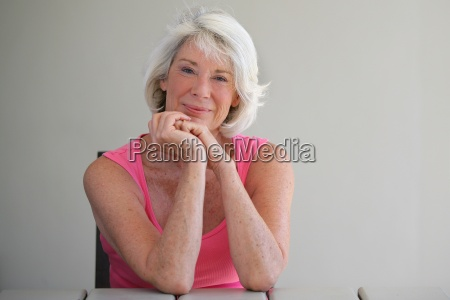 senior woman in a pink vest