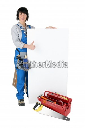 female craftsperson with toolcase and white