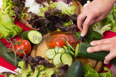 cutting fresh vegetables for salad